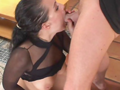Brunette in black nylon gives outstanding footjob