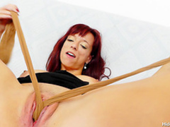 Redhead mom shows off her big tits