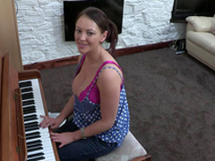 Busty brunette Vickie is playing on piano