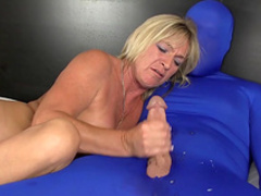Busty mom is wanking this hard dick