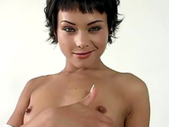 Short-haired brunette is touching her pussy