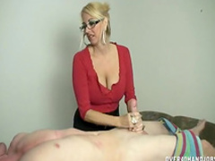 Pretty busty blonde in glasses is wanking a dick