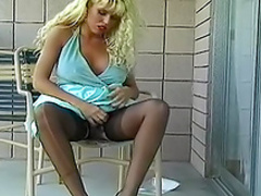 Sexy curly blonde is wearing her nice stockings