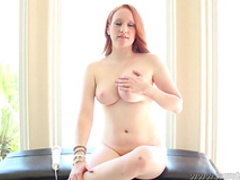 Curvy redhead beauty pokes her puss with vibrator