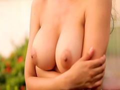 Shocking Latina presents her large breasts